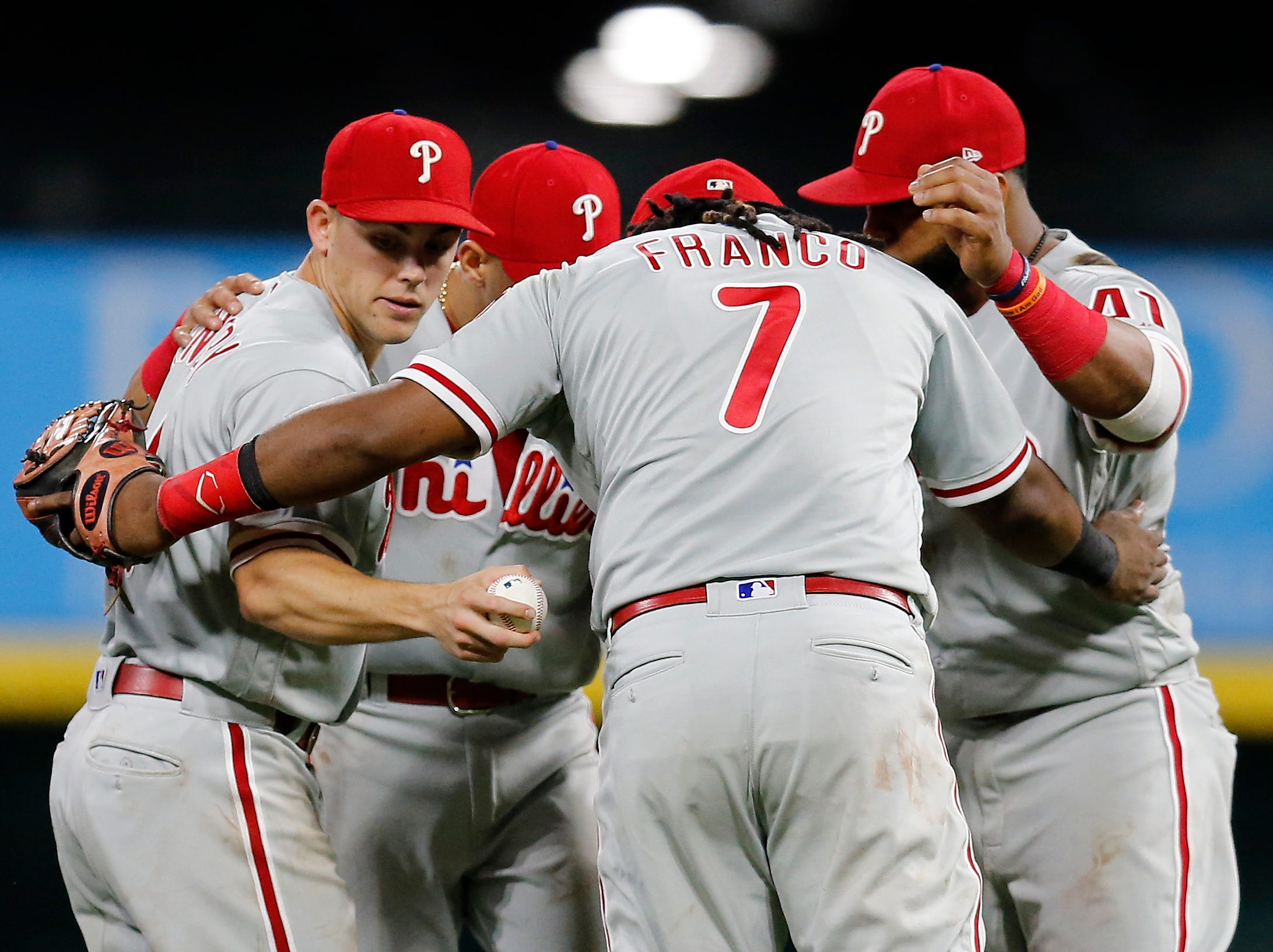 The Philadelphia Phillies celebrate a win after the ninth inning of the MLB National League game between the Cincinnati Reds and the Philadelphia Phillies at Great American Ball Park in downtown Cincinnati on Thursday, July 26, 2018. The Reds lost 9-4.