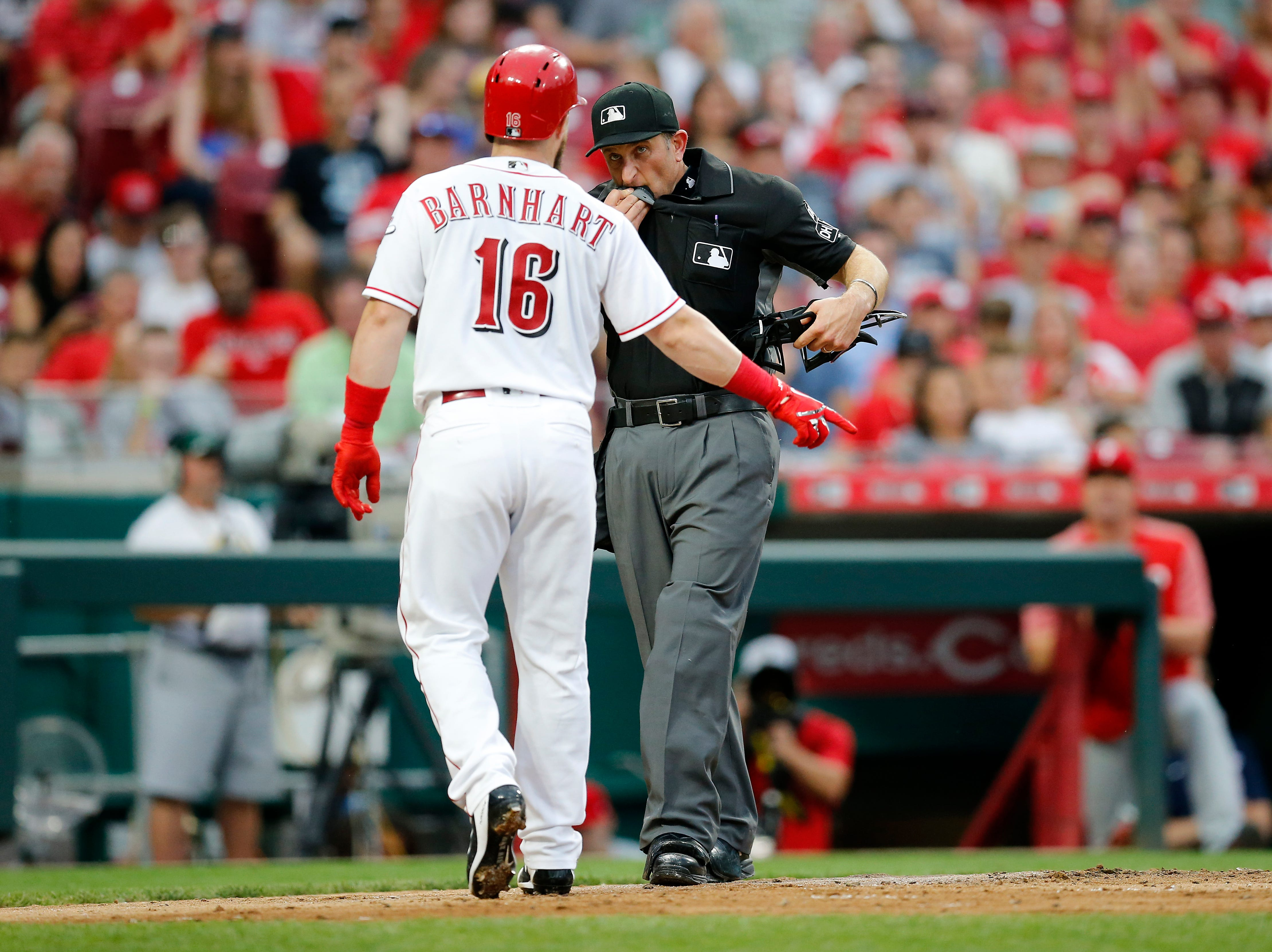 Cincinnati Reds catcher Tucker Barnhart (16) argues with umpire Chris Guccione (68) on a called third strike in the bottom of the second inning of the MLB National League game between the Cincinnati Reds and the Philadelphia Phillies at Great American Ball Park in downtown Cincinnati on Thursday, July 26, 2018. The Reds trailed 4-2 after three innings.