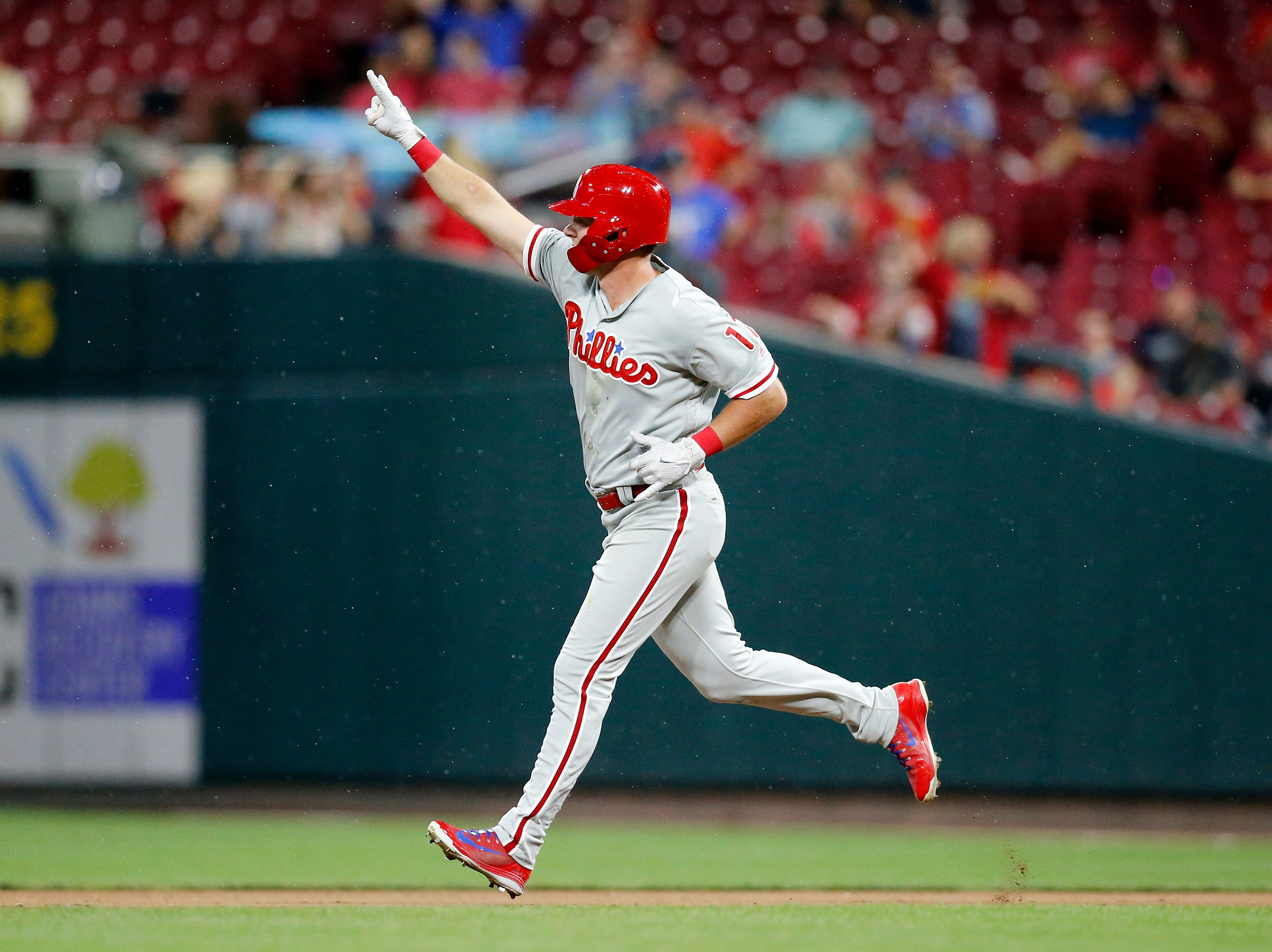 Philadelphia Phillies left fielder Rhys Hoskins (17) rounds the bases on his second home run of the night in the top of the sixth inning of the MLB National League game between the Cincinnati Reds and the Philadelphia Phillies at Great American Ball Park in downtown Cincinnati on Thursday, July 26, 2018. The Reds lost 9-4.