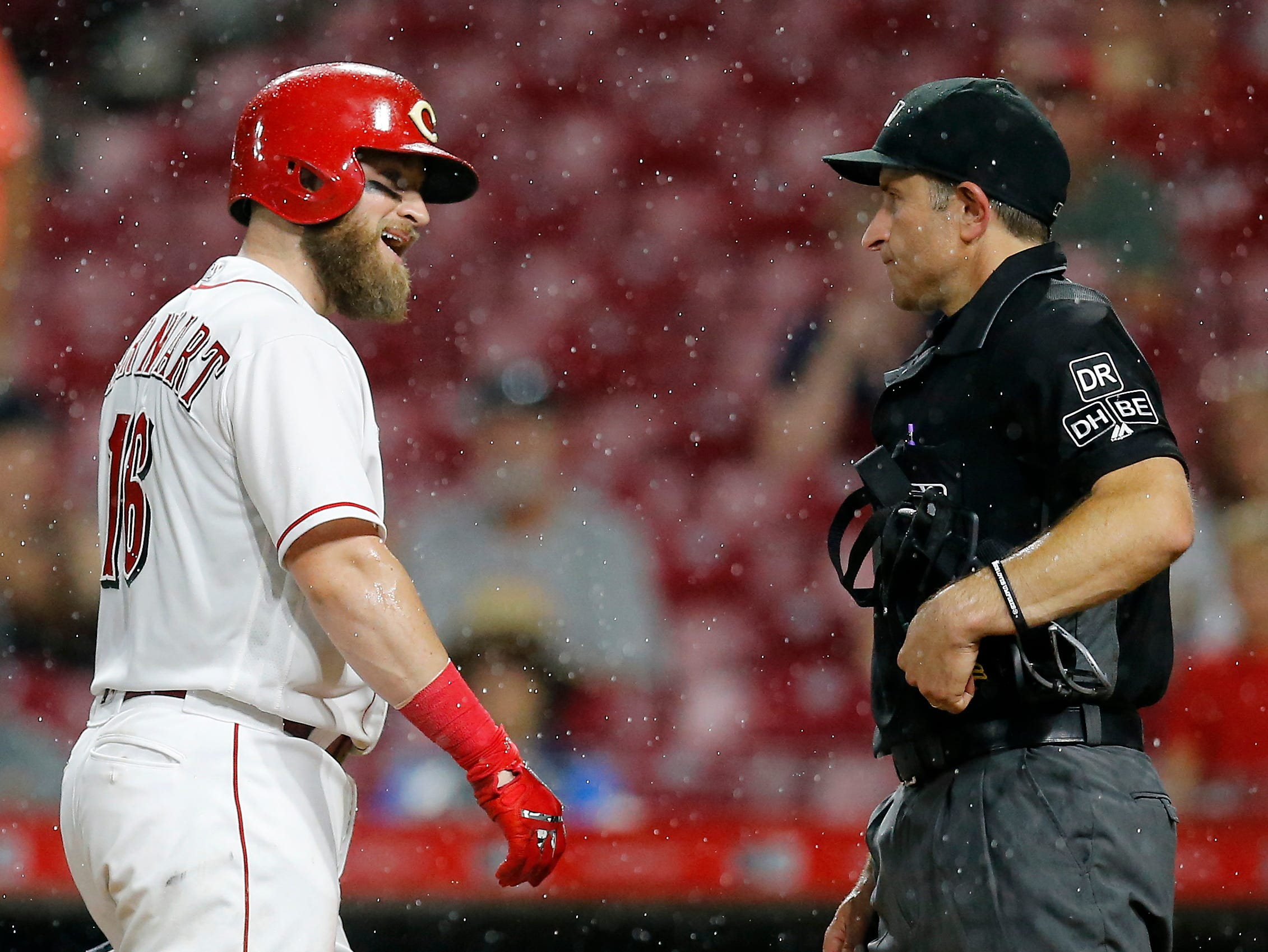 Cincinnati Reds catcher Tucker Barnhart (16) argues again with umpire Chris Guccione (68) on a strike out call in the bottom of the sixth inning of the MLB National League game between the Cincinnati Reds and the Philadelphia Phillies at Great American Ball Park in downtown Cincinnati on Thursday, July 26, 2018. The Reds lost 9-4.