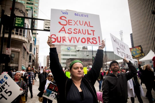 Thousands participate in the Cincinnati Women's March Saturday, January 20, 2018. The march started at the National Underground Railroad Freedom Center and marched a mile and a half to City Hall and back.
