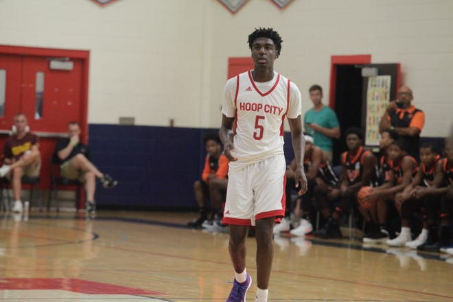 Five-star point guard Kira Lewis watches his teammates during the Las Vegas Summer Showcase.