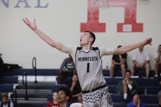 Five-star forward Matthew Hurt stretches for a rebound at the Las Vegas Summer Showcase.