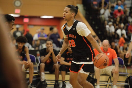 Three-star 2019 point guard Noah Hutchins dribbles past defender at the fab 48 in Las Vegas. Iowa is interested.