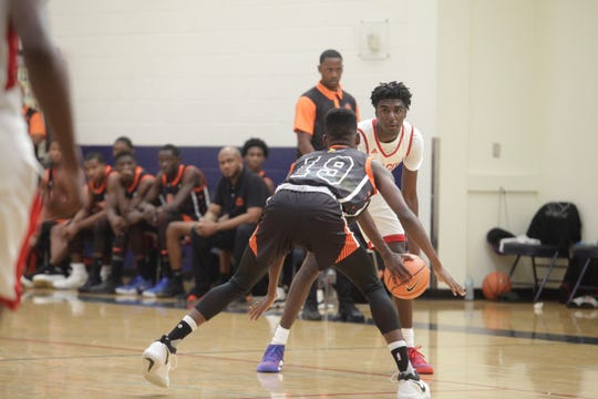 Five-star 2019 point guard Kira Lewis eyes a defender during the Las Vegas Summer Showcase.
