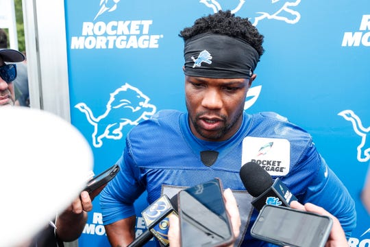 Lions safety Glover Quin talks to media after practice during training camp in Allen Park on Friday, July 27, 2018.