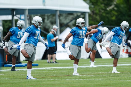 (From left) Lions defensive line Da'Shawn Hand (93), defensive line JoJo Wicker (96) and defensive tackle Jeremiah Ledbetter (98) practice during training camp in Allen Park on Friday, July 27, 2018.