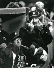 Detroit Tigers Jack Morris didn't think this picture would ever be published, so he gave Free Press photographer Mary Schroeder the bird while in the dugout between starts during a game at Tiger stadium.