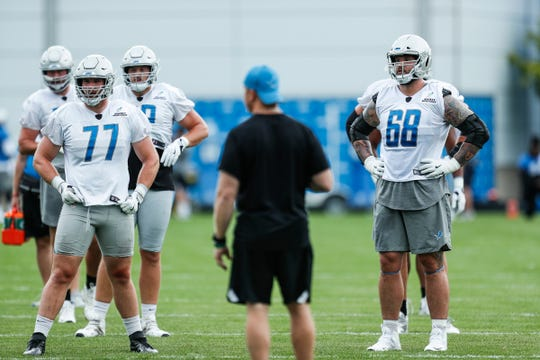 Lions offensive linemen Frank Ragnow (77), left, and Taylor Decker (68) practice during training camp in Allen Park on Friday, July 27, 2018.