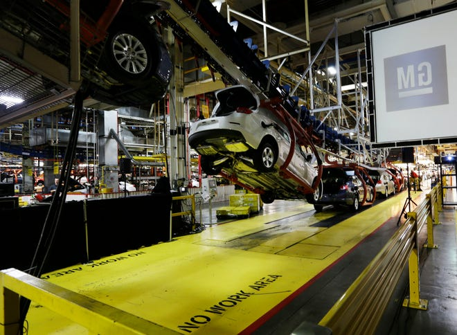 In this Monday, Jan. 28, 2013, file photo, cars move along an assembly line at the General Motors Fairfax plant in Kansas City, Kan. A