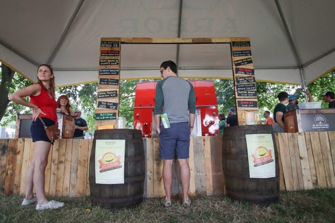 The Arbor Brewing tent at the Michigan Brewers' Guild Summer Beer Festival in Ypsilanti Friday.