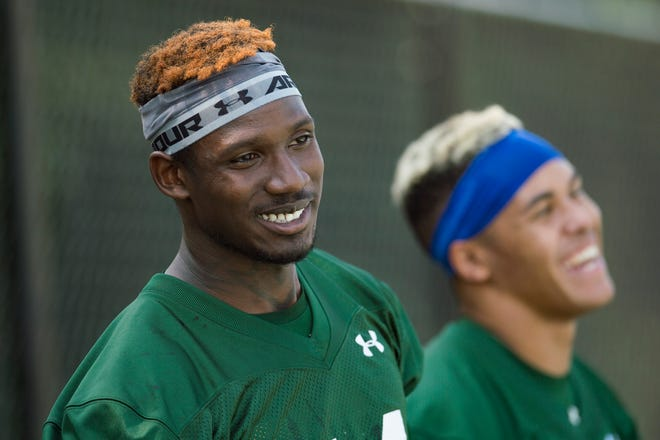 CSU receivers Preston Williams, left, and Bisi Johnson watch their teammates run drills during a July 27, 2018, practice. Williams, the Rams' leading receiver in 2018, was not invited to the NFL Scouting Combine because of a history of domestic violence, according to an NFL Network report, while Bisi Johnson, CSU's second-leading receiver for the past three seasons, was invited to the combine.