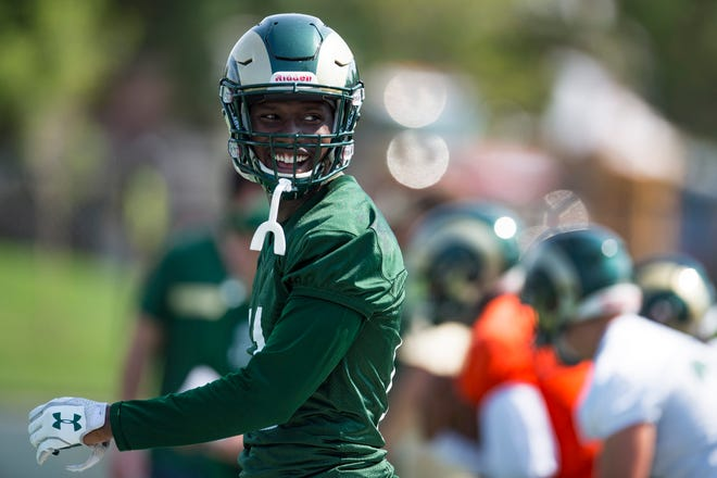 CSU wide receiver Preston Williams cracks a smile after a drill during the Rams' first practice of the season outside of Canvas Stadium on Friday, July 27, 2018.