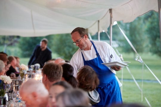 Chef Jason Shaeffer helps out with serving the dessert course at second summer Secret Supper at the Howling Cow Cafe, on Thursday, July 26, 2018.