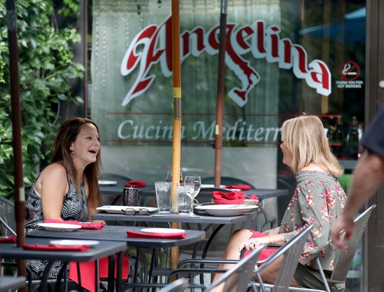 Diners enjoy the relaxed atmosphere in the outdoor space at Angelina, 117 N. Adams St.
