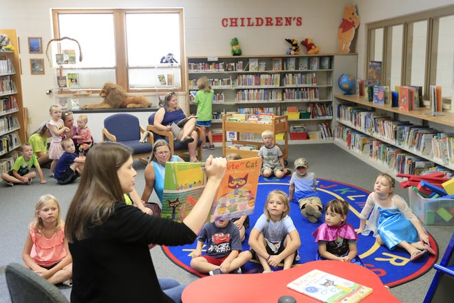 Brown County Children's Librarian Karin Adams reads 'Pete the Cat' during a story time event at the Brown County Library's Denmark branch.