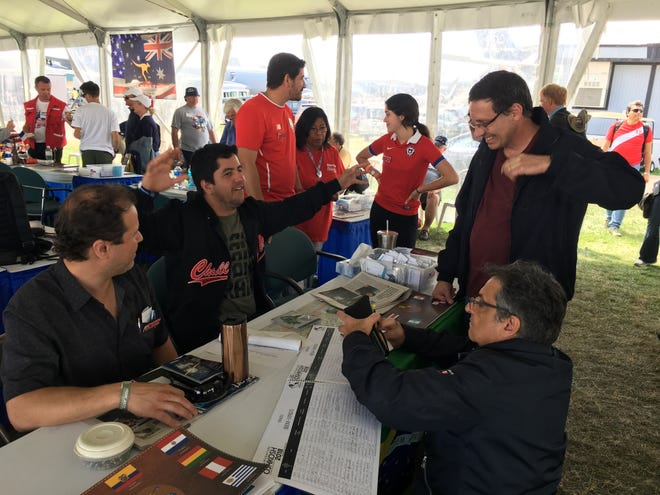 The International Tent at AirVenture helps with everything from accommodations to rides for the more than 2,000 international visitors to AirVenture this year.