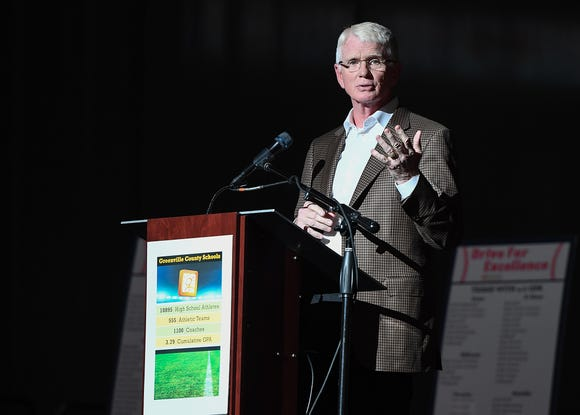 "Greenville Drive president and Co-owner Craig Brown speaks at the Greenville County Schools' ""Games+ Building a Better Graduate with Athletics"" Thursday at Bon Secours Wellness Arena in Greenville."