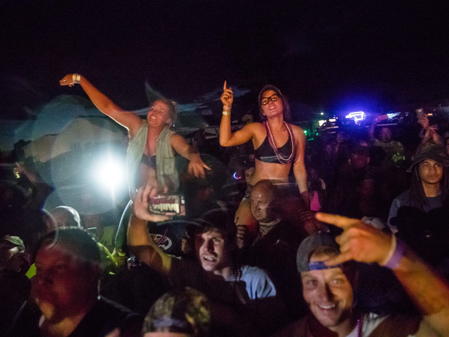 Music Fans get a better view during the concert at the Redneck Rave at BlackSwan Mudpit in Medora, Ind., on Friday, July 20, 2018.