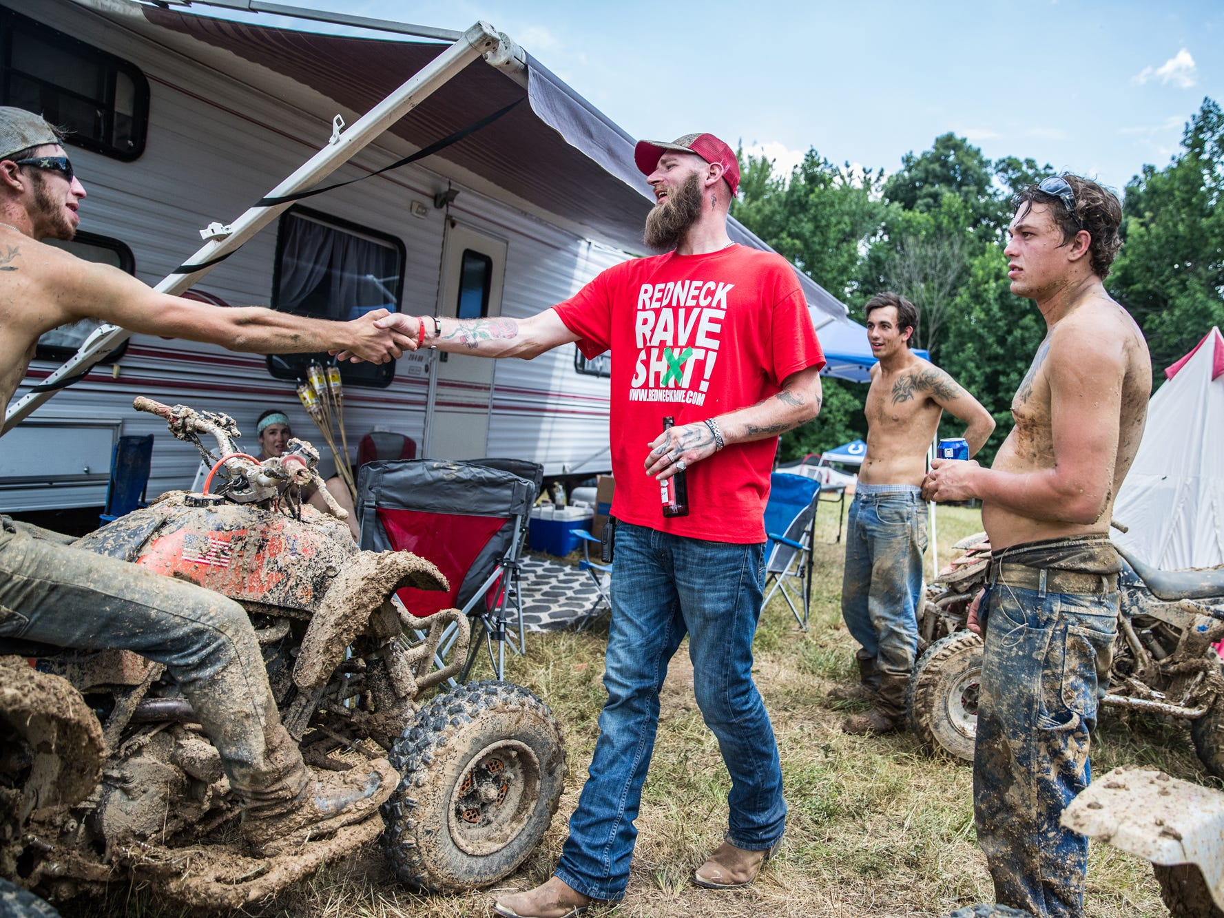 "Redneck Rave creator and music artist Justin Stowers walks around to talk to attendees of the Redneck Rave at BlackSwan Mudpit in Medora, Ind., on Friday, July 20, 2018. ""The beauty of the Redneck Rave is that it brings everybody together,"" said Stowers. ""It's America's wildest country party."""