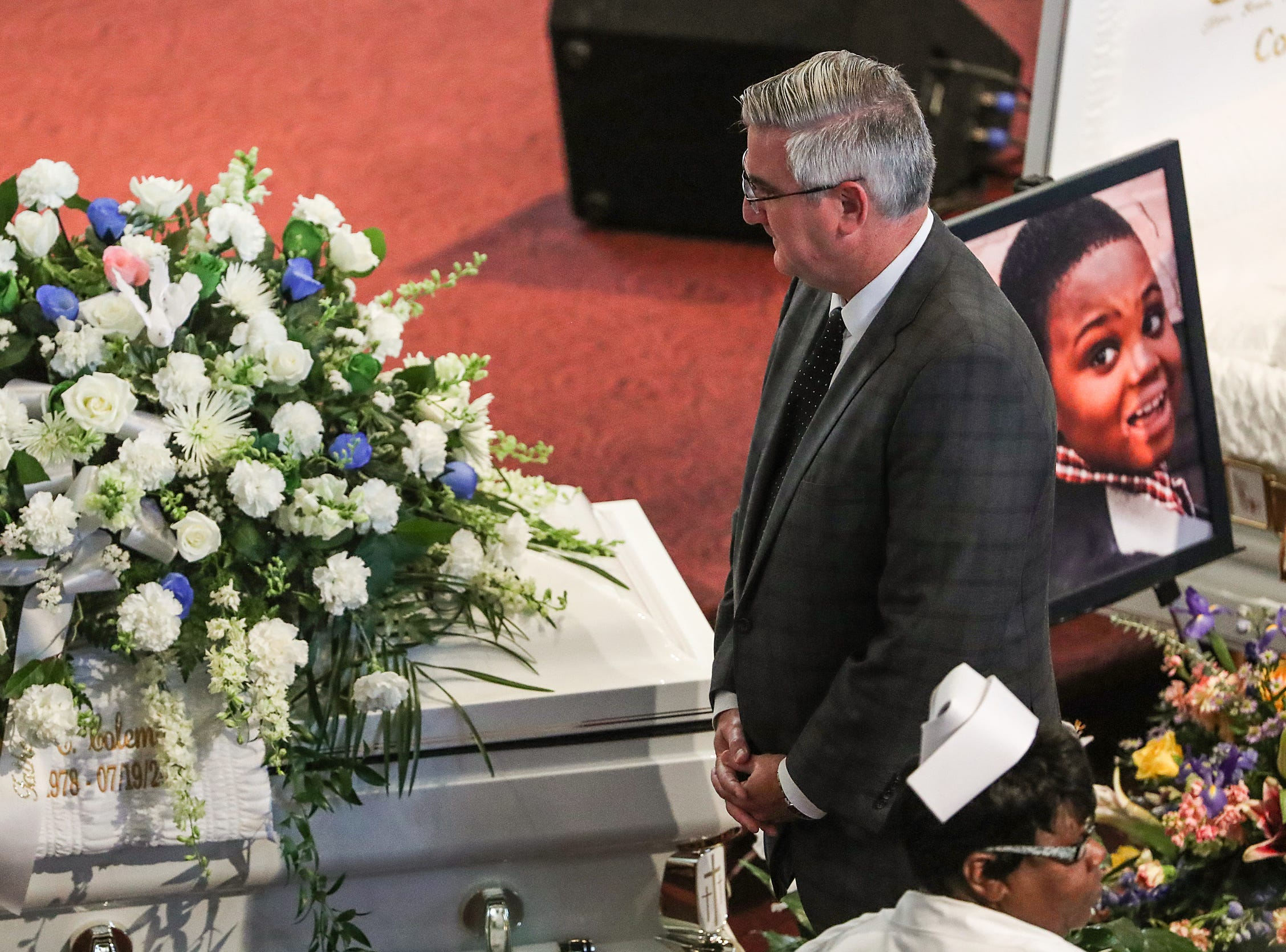 Indiana Gov. Eric Holcomb attends the homegoing service of Glenn Coleman, 40, Reece, 9, Evan, 7, and Arya, 1, at Grace Apostolic Church on Friday, July 27, 2018. Seventeen people were killed in the duck boat incident in Branson, Missouri, nine of them were members of the Coleman family.