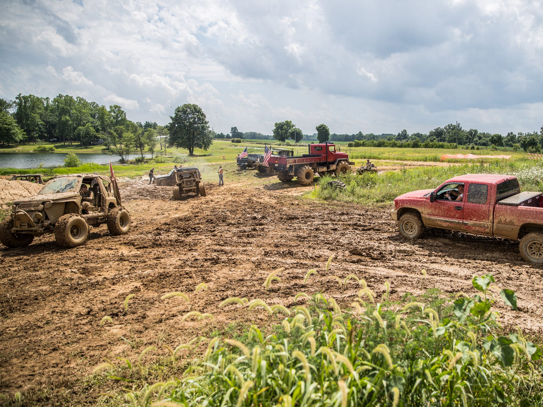 Participants enjoy the mud during the Redneck Rave at BlackSwan Mudpit in Medora, Ind., on Friday, July 20, 2018.