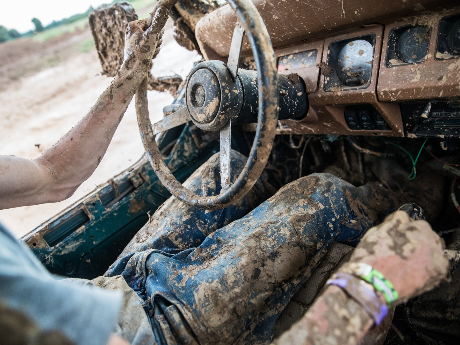 "Brandan Pryatt, of Williams, Ind., takes a 1995, 4 cylinder, 2.4 liter Jeep Wrangler up and over a large hill and though various mud pits during the Redneck Rave at BlackSwan Mudpit in Medora, Ind., on Friday, July 20, 2018. ""I plan to blow this engine this weekend,"" he said. ""I'm going to run it hard."""