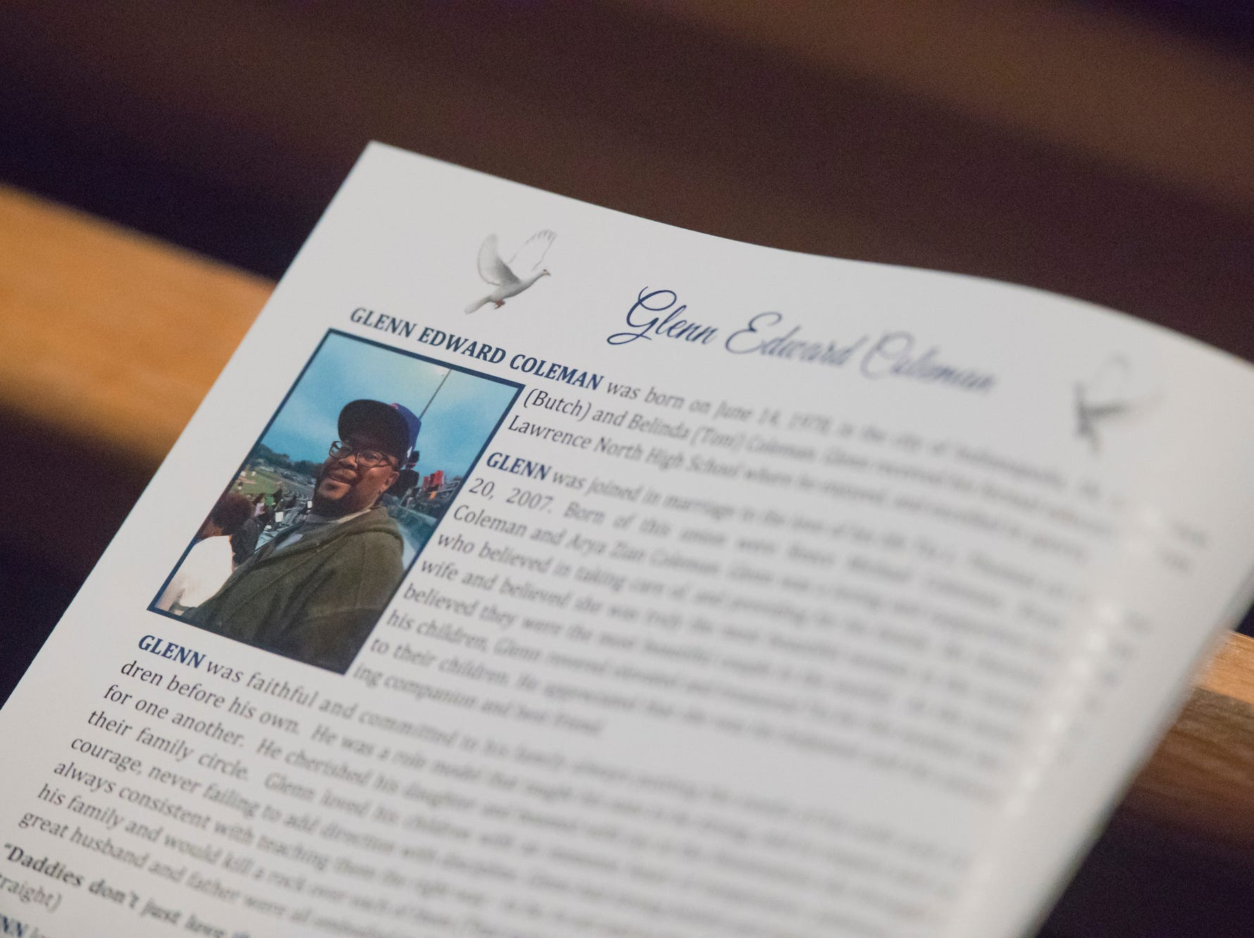 Glenn Edward Coleman's obituary is read during the homegoing service of Glenn Coleman, 40, Reece, 9, Evan, 7, and Arya, 1, at Grace Apostolic Church on Friday, July 27, 2018. Seventeen people were killed in the duck boat accident in Branson, Missouri, nine of them were members of the Coleman family.