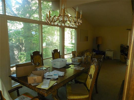 The dining area was originally separated from the kitchen by a wall.