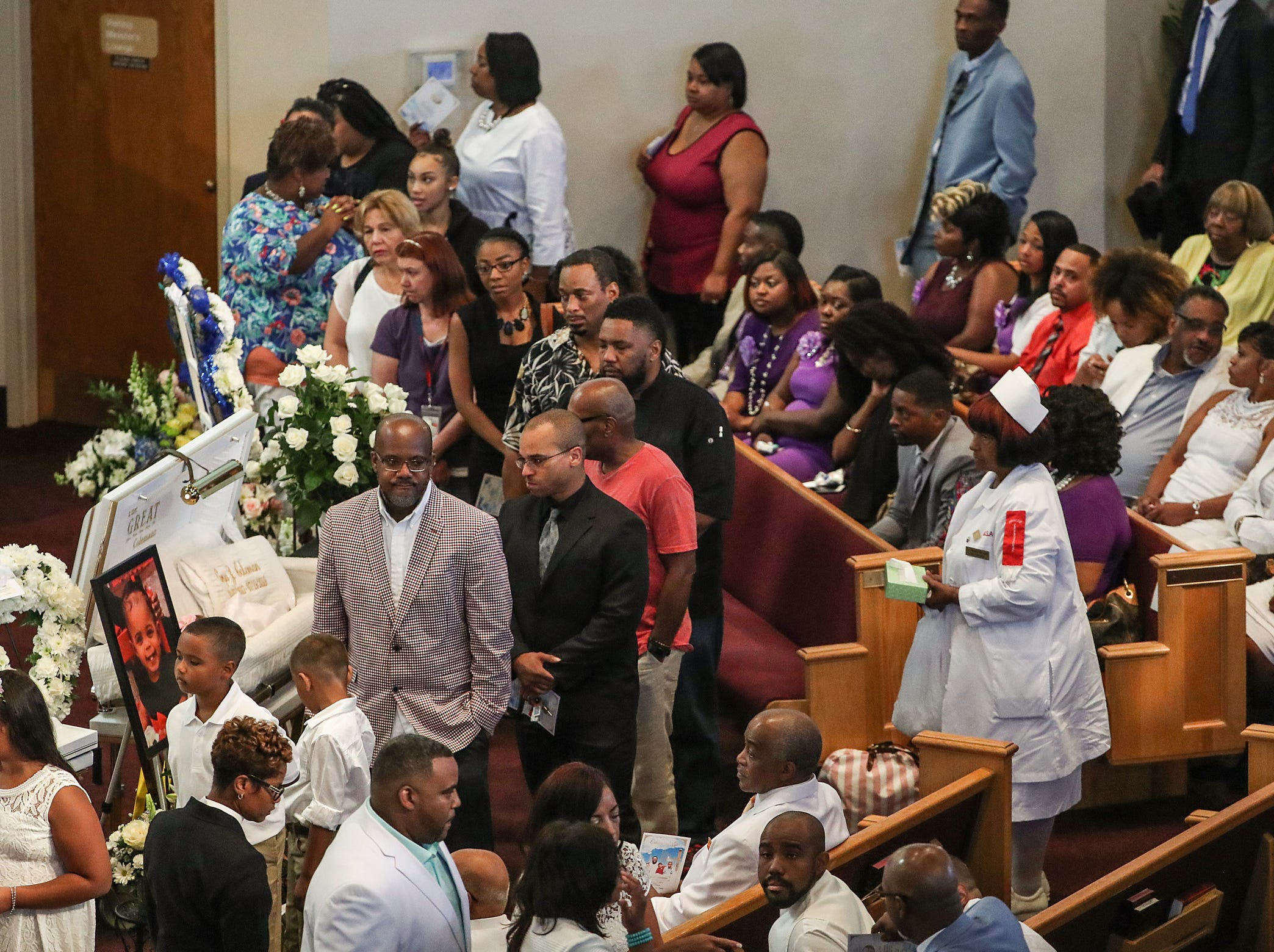 Family and friends gather for a viewing before the homegoing service of Glenn Coleman, 40, Reece, 9, Evan, 7, and Arya, 1, at Grace Apostolic Church on Friday, July 27, 2018. Seventeen people were killed in the duck boat incident in Branson, Missouri, nine of them were members of the Coleman family.