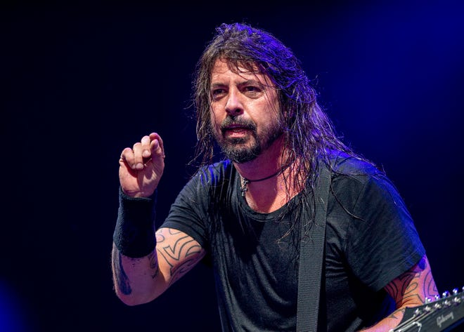 Dave Grohl consults with the crowd during Thursday's Foo Fighters show at Ruoff Home Mortgage Music Center.