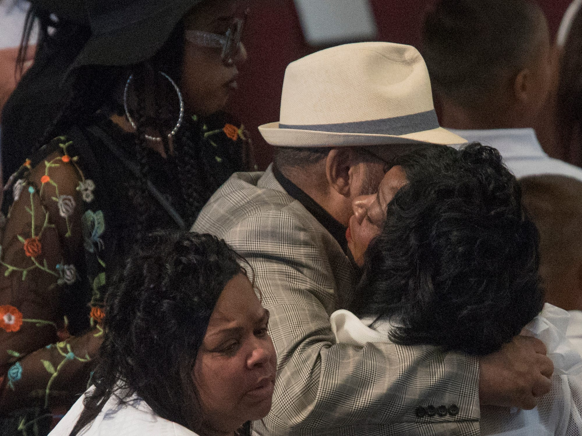 Family and friends embrace Denina Cupid Sharp before the homegoing service of Glenn Coleman, 40, Reece, 9, Evan, 7, and Arya, 1, at Grace Apostolic Church on Friday, July 27, 2018. Seventeen people were killed in the duck boat accident in Branson, Missouri, nine of them were members of the Coleman family.