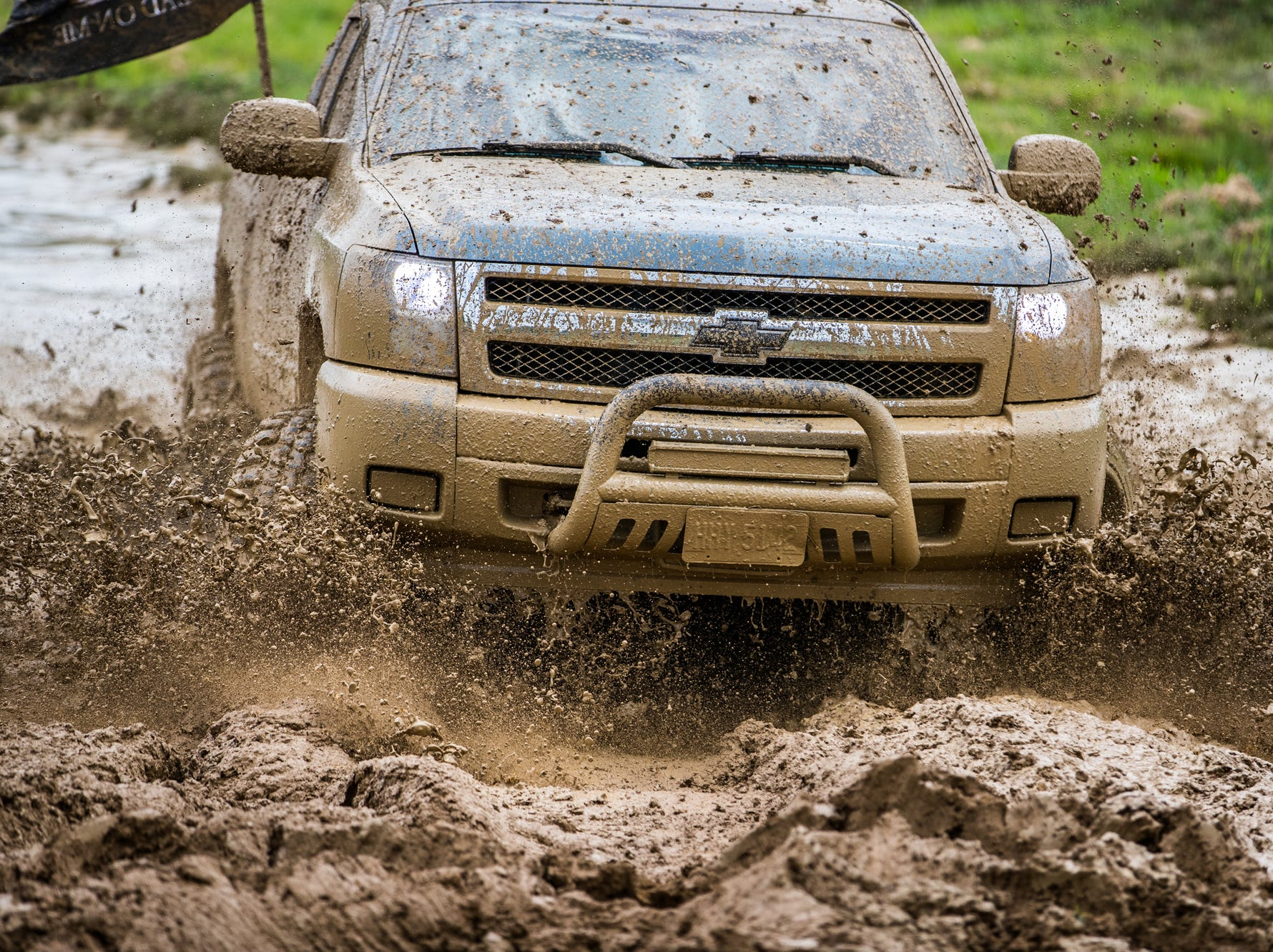 A Chevrolet  truck trudges through the mud during the Redneck Rave at BlackSwan Mudpit in Medora, Ind., on Friday, July 20, 2018.