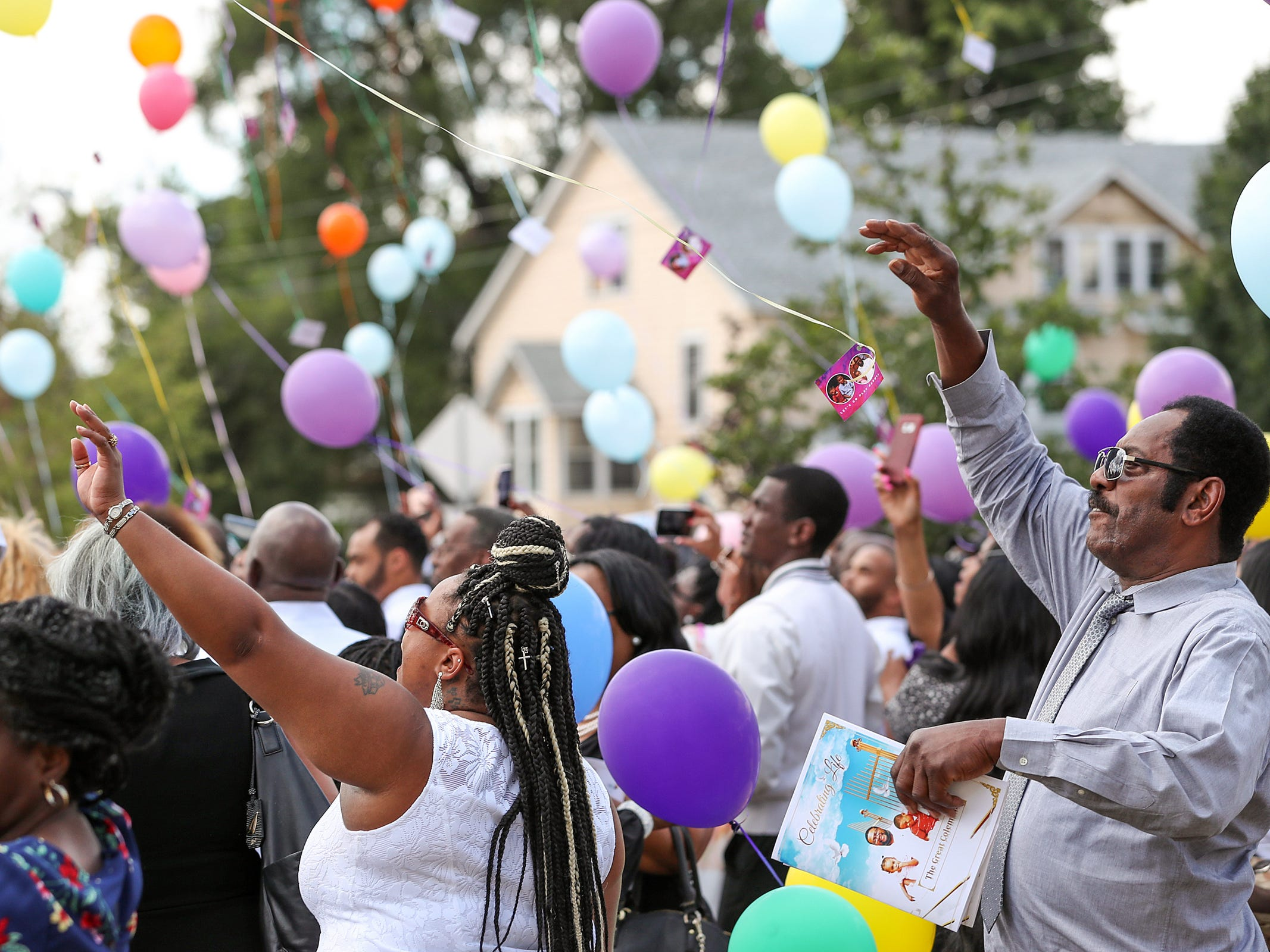 Family and friends participate in a balloon release after the homegoing service of Glenn Coleman, 40, Reece, 9, Evan, 7, and Arya, 1, at Grace Apostolic Church in Indianapolis on Friday, July 27, 2018. Seventeen people were killed in the duck boat incident in Branson, Missouri, nine of them were members of the Coleman family.