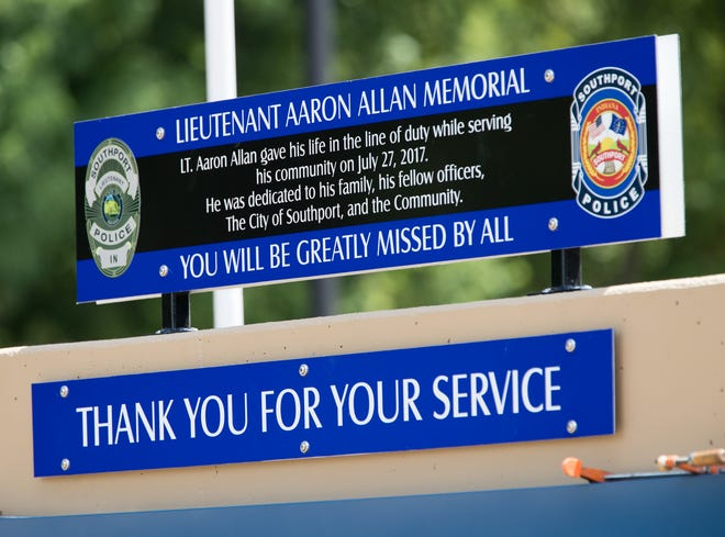 A dedication for a memorial for Aaron Allan, a Southport Police Department officer who was shot and killed during a traffic stop a year eariler, Friday, July 27, 2018.