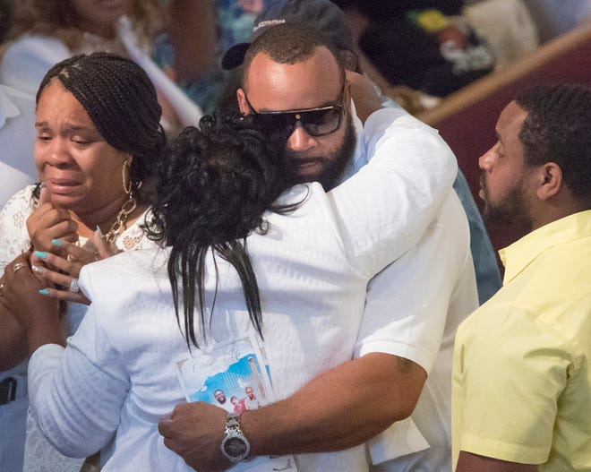 Family and friends gather for the homegoing service of Glenn Coleman, 40, Reece, 9, Evan, 7, and Arya, 1, at Grace Apostolic Church on Friday, July 27, 2018. Seventeen people were killed in the duck boat accident in Branson, Missouri, nine of them were members of the Coleman family.