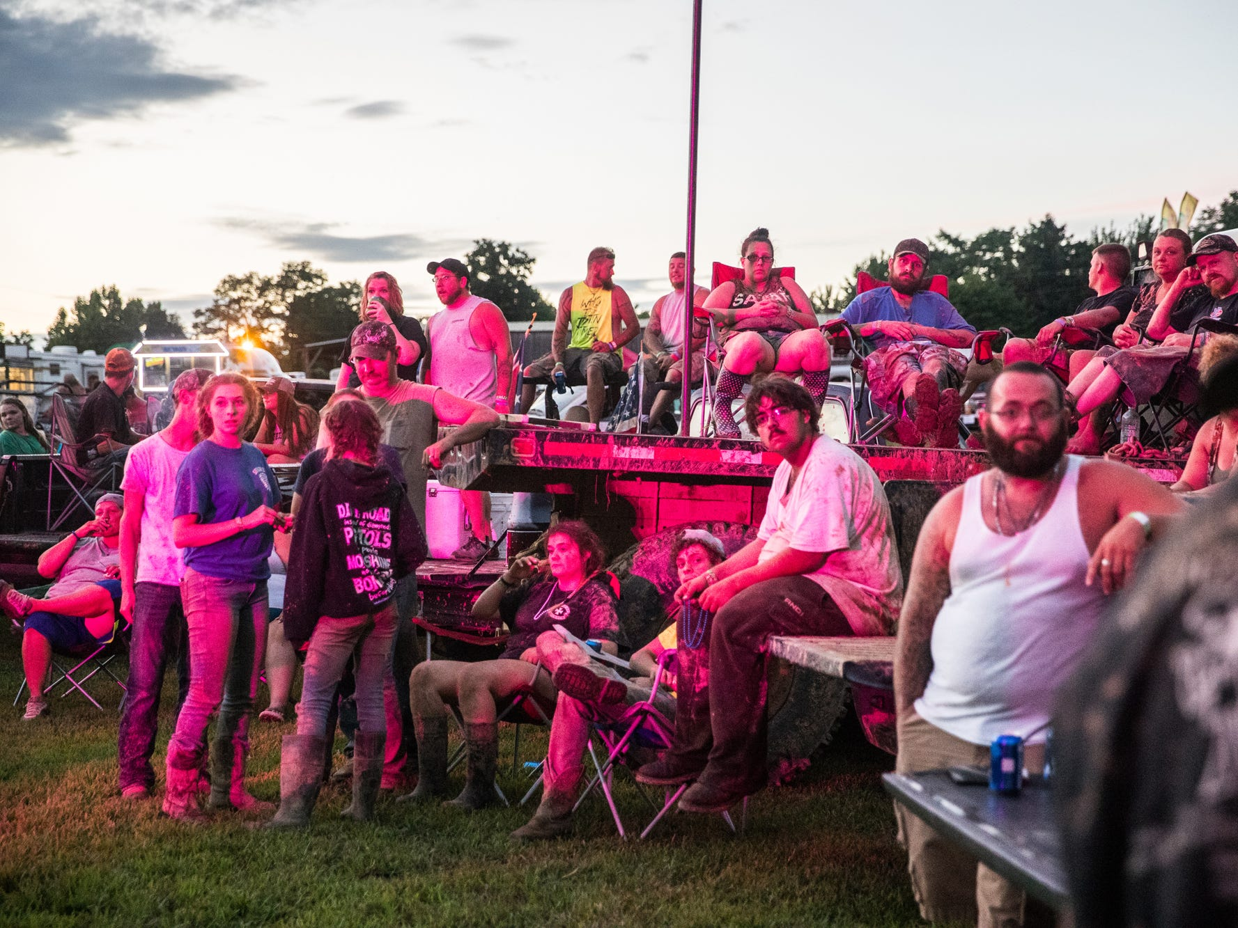 After a day of mudding during the Redneck Rave at BlackSwan Mudpit in Medora, Ind., attendees park their ATV's and trucks near the music stage on Friday, July 20, 2018.