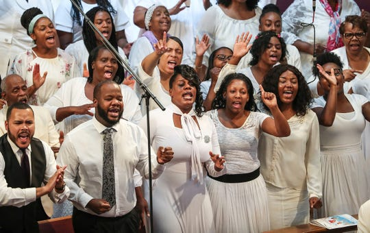 The Agape Apostolic Faith Choir performs at the homegoing service of Glenn Coleman, 40, Reece, 9, Evan, 7, and Arya, 1, at Grace Apostolic Church in Indianapolis on Friday, July 27, 2018. Seventeen people were killed in the duck boat incident in Branson, Missouri, nine of them were members of the Coleman family.