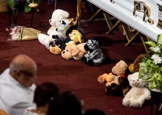 A detail of toys placed in front of the children's caskets for the homegoing service of Glenn Coleman, 40, Reece, 9, Evan, 7, and Arya, 1, at Grace Apostolic Church on Friday, July 27, 2018. Seventeen people were killed in the duck boat accident in Branson, Missouri, nine of them were members of the Coleman family.