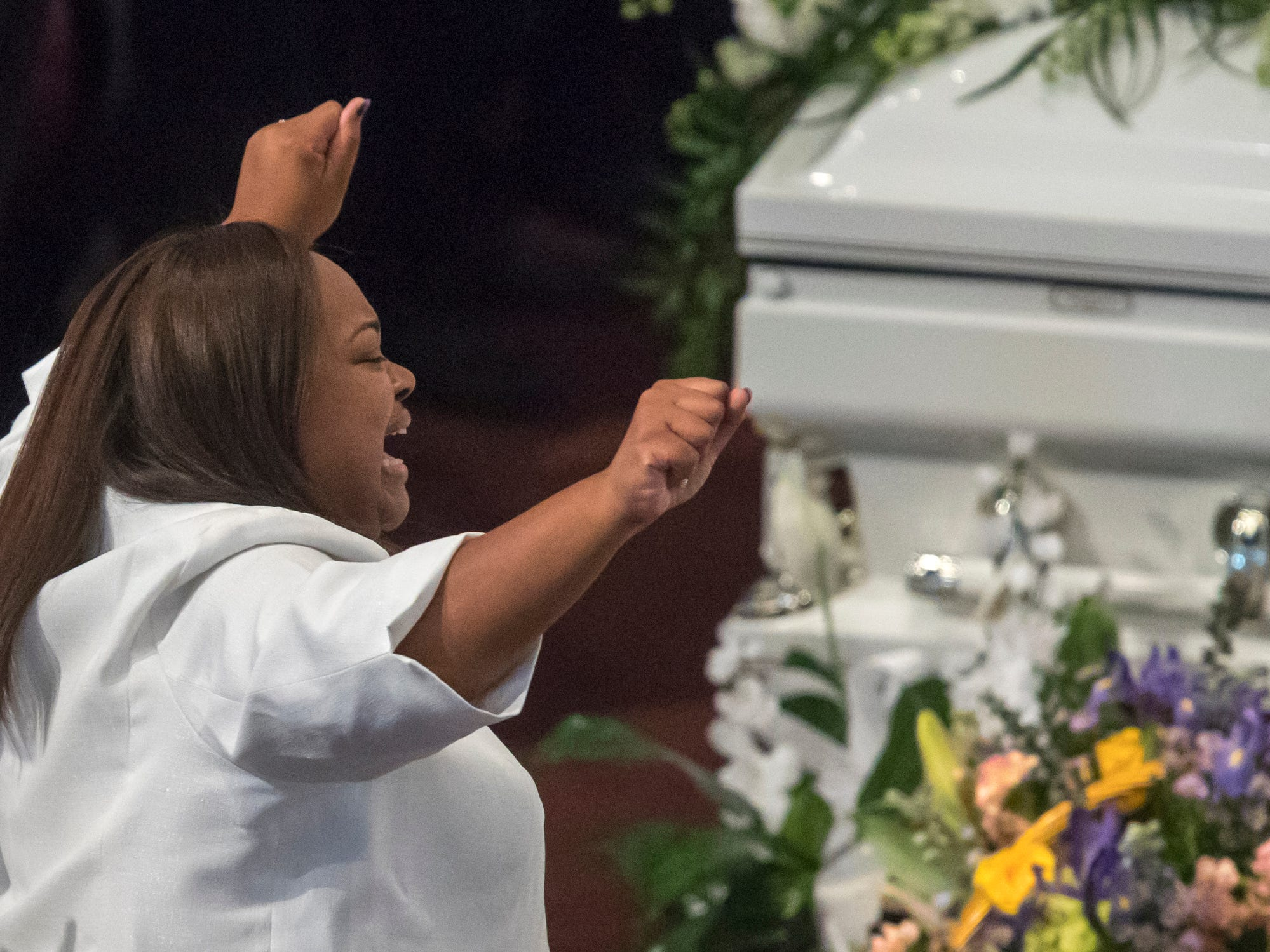 Tia Coleman is moved by a praise dance the dance team performed during the homegoing service of Glenn Coleman, 40, Reece, 9, Evan, 7, and Arya, 1, at Grace Apostolic Church on Friday, July 27, 2018. Seventeen people were killed in the duck boat accident in Branson, Missouri, nine of them were members of the Coleman family.