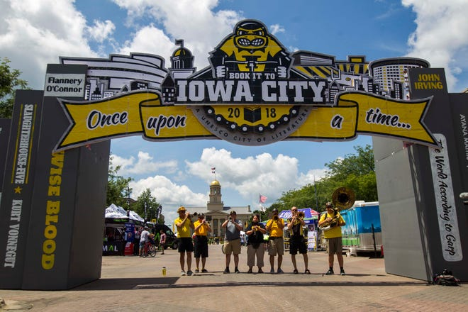 Members of the University of Iowa Alumni Band performs along Iowa Avenue in Iowa City during an overnight stop along RAGBRAI on Friday, July 27, 2018, in eastern Iowa.