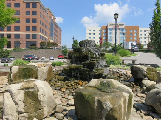 The Brookview Town Centre's fountain park, shown on July 26, 2018, is considered an oasis in the middle of commercial development.