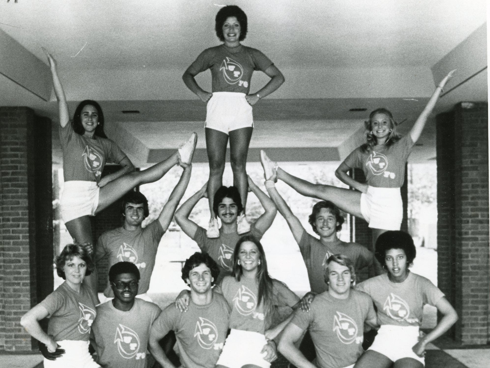 The 1976 UT cheerleaders included (front) Sandy Symes, Joel Weathers, Jim Petway, Pam Johnson, Curtis Epperson, Cheryl Williams; (back) Ann Runyan, Chuck Lyle, Sandy Reel co-captain, John Ferreri Terry Clark captain and Gayle Hawkins.