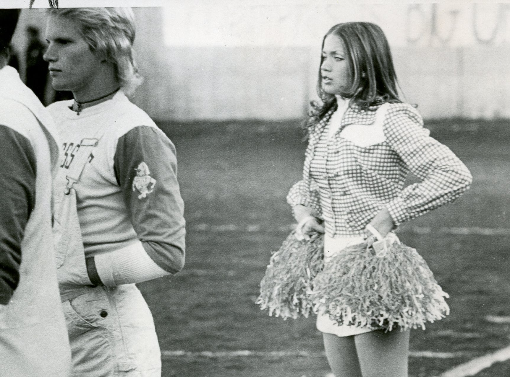 UT cheerleader Julie Brown and Smokey at Ole Miss. November, 1975.