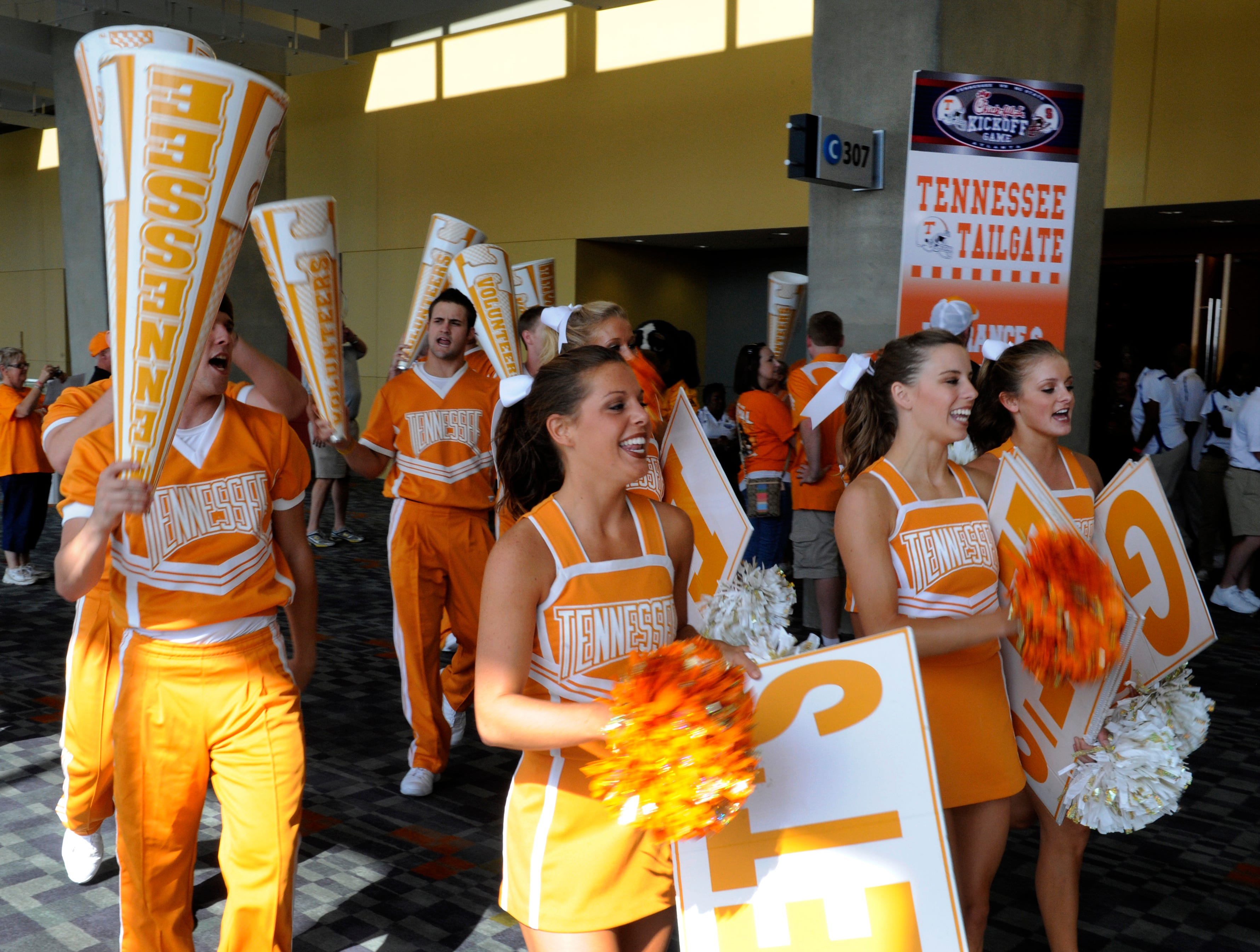The UT cheerleaders leave a tailgate party in the Georgia World Congress Center Friday, Aug. 31, 2012 in Atlanta prior to the Chick-fil-A Kickoff Game.