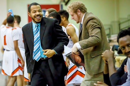 Coach Darren Higgins, left, talks with student assistant Brennan Hollowell during the 2017-18 Tusculum College basketball season. The Bearden High graduate is now a full-time assistant.