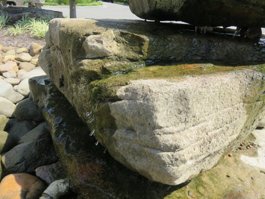 A cross-bedded rock at the Brookview Town Centre fountain park.