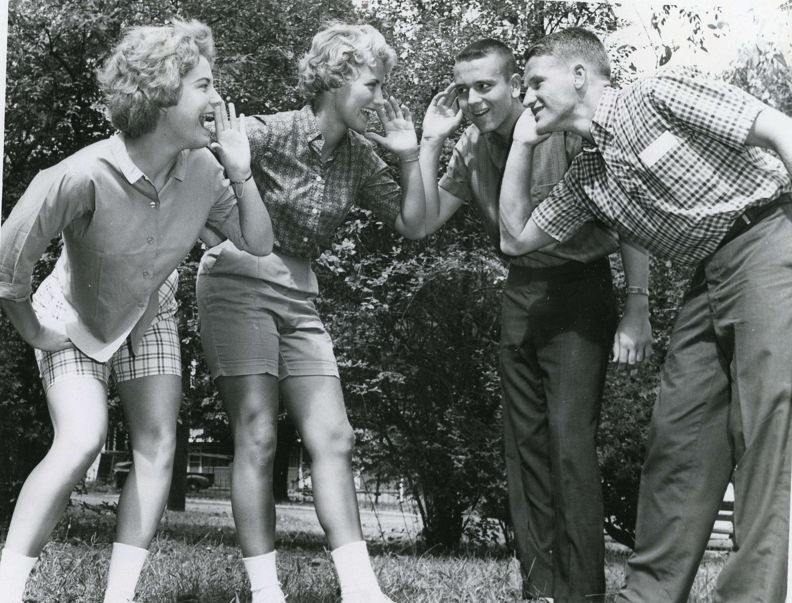 """Let's Get a Little Bit Louder"" with these 1961 UT cheerleaders, Janet Stanford, Wallene Threadgill, L.D. Word and Jack Webb."