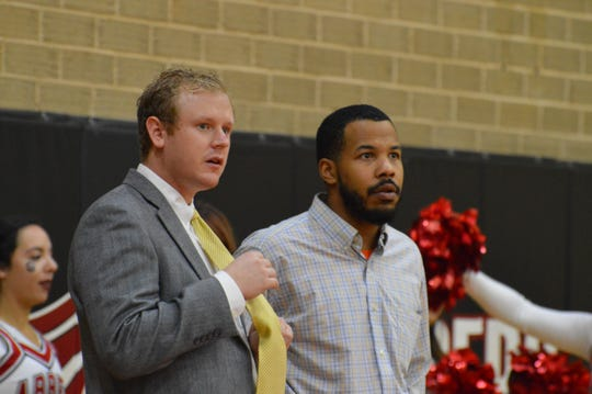 Darren Higgins, right, with student assistant Brennan Hollowell, has paid his dues at several programs and is thankful to have been given the chance at full-time coaching at Tusculum College.