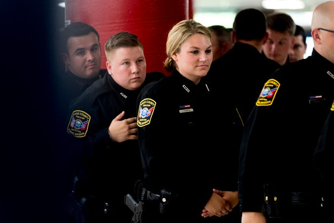 Officer Jessica Cinnamon waits to walk into the ceremony during graduation for school security officers at South-Doyle Middle School in Knoxville, Tennessee on Thursday, July 26, 2018. Knox County Schools graduated twenty-four new officers for the upcoming school year.